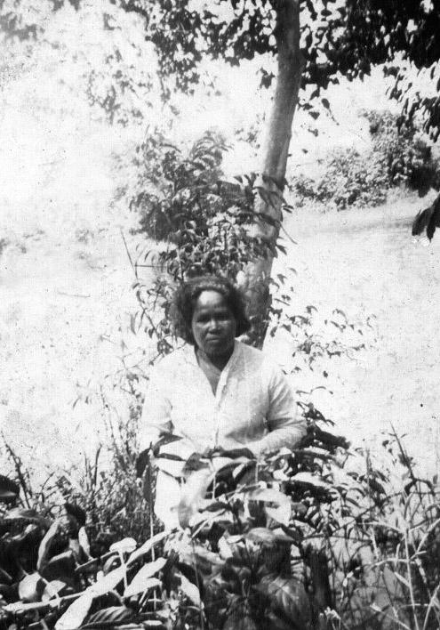 Dinah Benton sitting on ground in Djkarta